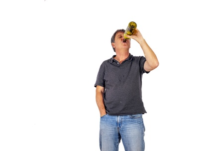 mature man drinks alcohol out of a bottle Stock Photo - 17076901