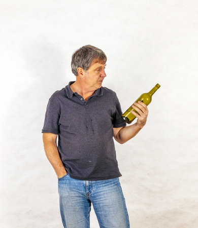 mature man drinks alcohol out of a bottle Stock Photo - 17076833