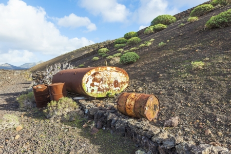 old tank in volcanic landscape in Lanzarote in the national Park photo