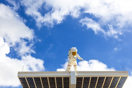 ORLANDO, USA - JULY 25: an Astronaut in his Space suit is watching the entrance of the Kennedy space center  on July 25, 2010 in Orlando, USA. Stock Photo - 17069753