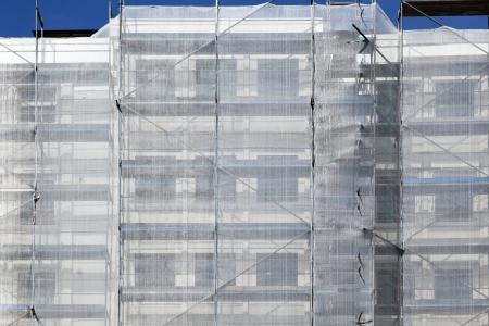 rearrange: scaffold at a house facade Editorial