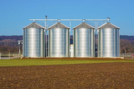 silver silo in rural landscape Stock Photo