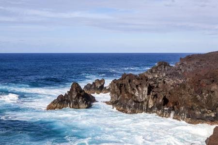 los hervideros: rough cliffs at the shore of Lanzarote by Los hervideros Stock Photo