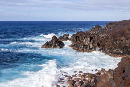 rough cliffs at the shore of Lanzarote by Los hervideros Stock Photo