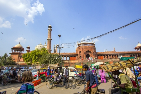 jama mashid: DELHI, INDIA - OCTOBER 15: people enter the Jama Masjid throug gate No 1 on October 15, 2012 in Delhi, India. The mosque is surrounded by markets and  trafic.