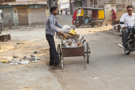 social outcast: JODHPUR, INDIA - 23 NOVEMBER: man of fourt class cleans the street on November 23,2012 in Jodhpur, India. They earn 300 IRP for two hours paid by the government.
