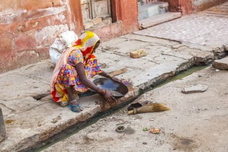 bikaner: BIKANER, INDIA - OCT 24: woman tries to find gold dust in the canalisation of the gold smith area on October 23, 2012 in Bikaner, India.