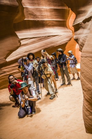 guided: PAGE, USA JULY 07: Photographers shooting of the upper Antelope Canyon in Midday light on July 07, 2008 in Page, USA. The indians offer special guided tours for fotografers to get best light.