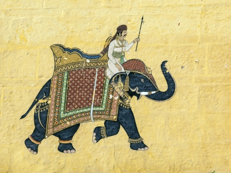 rajput: colorful indian mural in the fort at Jodhpur showing a royal procession, including elephant  from the Rajput era