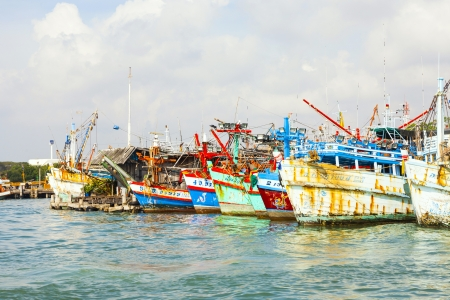 PHE, THAILAND JAN 1: fisherboats in the harbor on Jan 1, 2010 in Phe, Thailand. In 2008  fishing contributed only 2.5 percent to GDP.