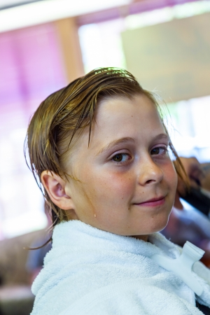 haircutter: young boys at the hairdresser Stock Photo