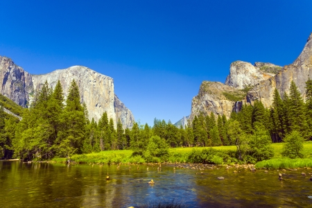 merced: view to western rocket plateau of yosemite national park seen from beautiful Merced river