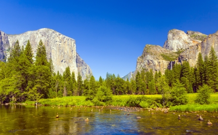 view to western rocket plateau of yosemite national park seen from beautiful Merced river photo