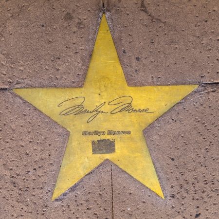 PHOENIX, USA - June 14: The name of Marilyn Monroe in copper reflect the past glory of the Hotel San Carlos on June 14,2012 in Phoenix, USA. The stars in the sidewalk were put in in 1993 to commemorate their visits.