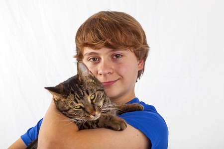cute boy hugging his cat in the arm Stock Photo - 17368074
