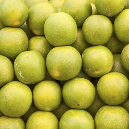 stapled: green fresh limette stapled at the market Stock Photo