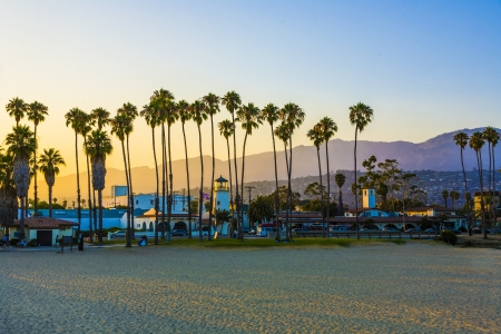 scenic promenade with lighthouse and palms in Santa Barbara in sunset photo