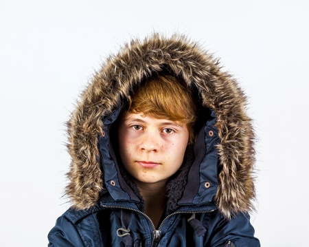 portrait of freezing boy in winter clothes photo