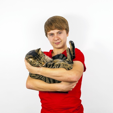 boy hugging with his cute tiger cat photo