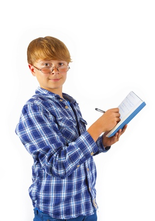happy smart boy is reading in a book Stock Photo - 17486599