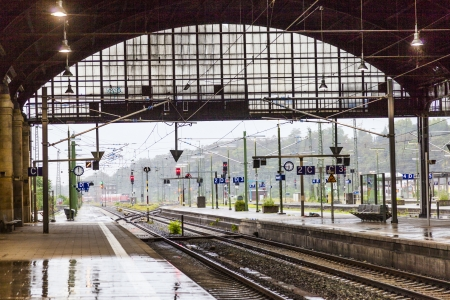 rain shower: rails and signal lamps  in historic Wiesbaden central train station Stock Photo