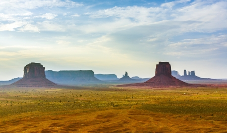 giant Buttes, formations  made of sandstone in the Monument valley seen from Artists point at sunset photo