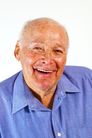 portrait of laughing happy elderly man in front of a white background photo