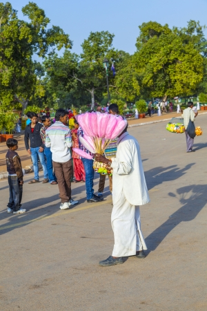 india gate: DELHI, INDIA - OCT 16: sales people at India gate offer cotton candy to indian tourists on OCT 16, 2012 in Delhi, India. India gate is the symbol for the British retreatment and a must to see for any indian.