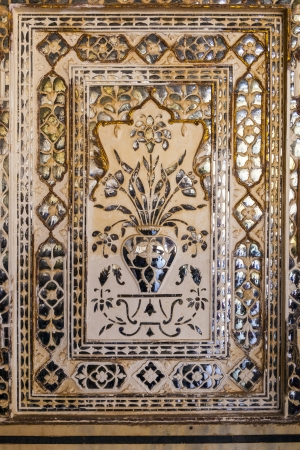 historica: details of walls with silver and mirrors in rich decorated Amber fort. Jaipur. India Editorial