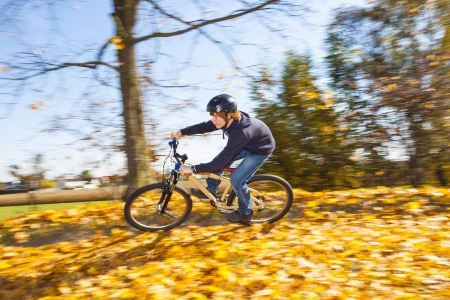 dirt bike: boy jumps with his dirt bike over natural ramps in open area and enjoys racing