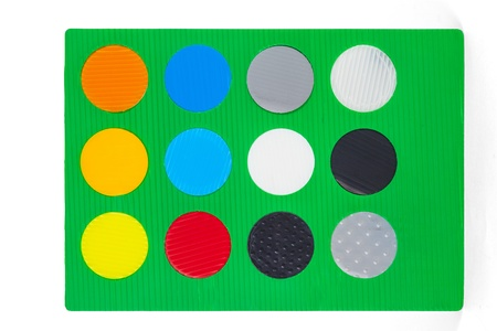 green sheet with different colorful round color samples photo