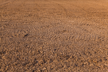 mark of plow on freshly plowed field photo