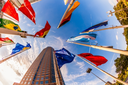 messe: FRANKFURT, GERMANY - SEP 12: flags at Messeturm on Sep 12, 2009 in Frankfurt, Germany. - Fair Tower of Frankfurt, Germany. The tower was in 1990 Europes tallest building with 257 m (843 ft).