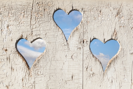 Heart shape look out on wooden door to outhouse. bleach Stock Photo - 17648873