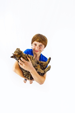 boy holding his cat in the arms photo