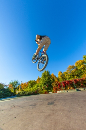 dirt bike: boy is going airborne with his dirt bike Stock Photo