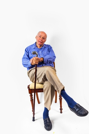 happy elderly man sitting in front of a white background photo