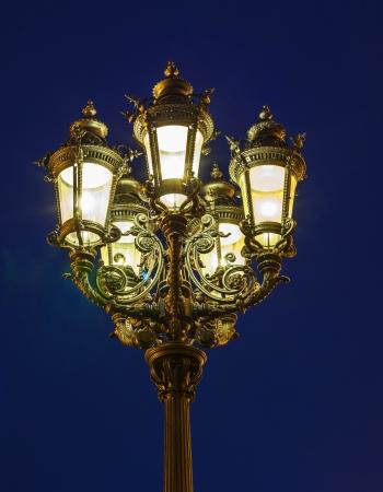 old lantern by night in Frankfurt photo