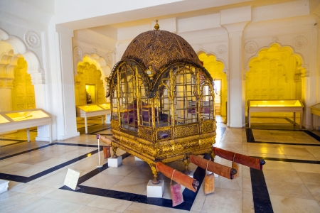 JODHPUR, INDIA - OCT 22: Mahadol, the Palanquin at Mehrangarh fort on Oct 22,2012 in Jodhpur, India. The fort was built in 1459  by Rao Jodha. It was in use till 1943. It is one of the most well-stocked museums in Rajasthan nowadays.