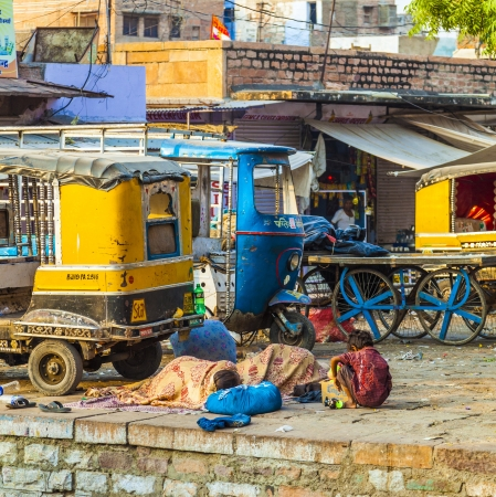 JODHPUR, INDIA - OCT 23: Poverty in India, people sleep at the street on October 22, 2012 in Jodhpur, India. More than 90 million people in India make less than $1 USD per day, thus setting them below the global poverty threshold.