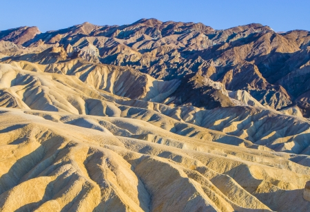 borax: Picturesque soft waves from multi-coloured sandstone. Death valley, Zabriski - a point on a sunset