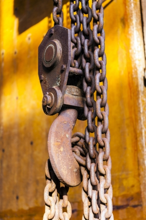 old rusty chain with hook of a crane photo