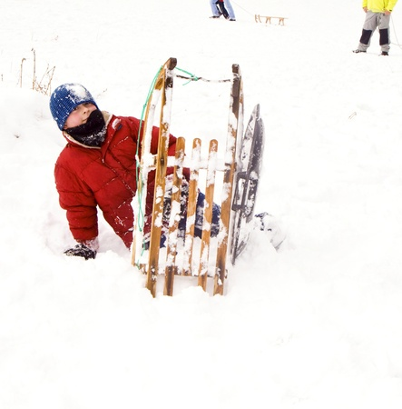 children are sledding down the hill in snow, white winter photo