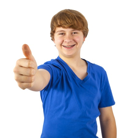 A smiling boy is showing his thumb up; isolated on the white background Stock Photo - 17793589
