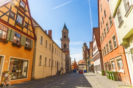 middleages: DINKELSBUEHL, GERMANY - JULY 22: romantic Dinkelsbühl, city of late middleages and timbered houses on July 22, 2019 in Dinkelsbuehl, Germany. Fortified by the emperor Henry V, Dinkelsbühl received in 1305 the same municipal rights as Ulm, and obtained i