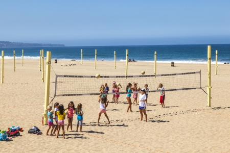 MANHATTAN BEACH, USA - June 25: people play volleyball and train at the beach on June 25 in Manhattan Beach, USA.  The first Manhattan Beach Open was held here in 1960,  also called  Wimbledon of Beach Volleyball.