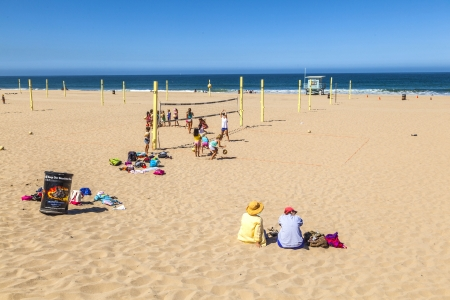 MANHATTAN BEACH, USA - June 25: people play volleyball and train at the beach on June 25 in Manhattan Beach, USA.  The first Manhattan Beach Open was held here in 1960,  also called  'Wimbledon of Beach Volleyball'.