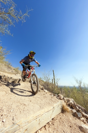 tuscon: TUSCON, USA - JUNE 11: downhill bike rider in TUSCON, USA on June 11, 2012.  There are around 1,000 bicycle related deaths in the United States each year, 75% of which are due to head injuries.