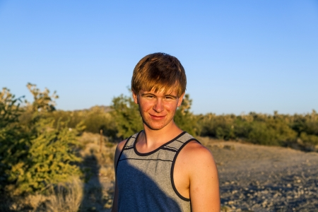sunset with smiling attractive boy in Joshua tree landscape Stock Photo - 17848682