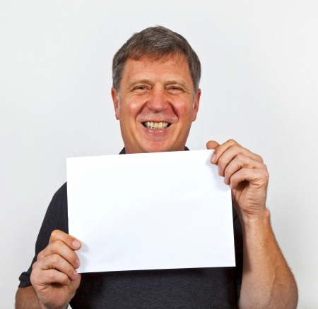 trustful: smart man holding an empty poster in his hand Stock Photo